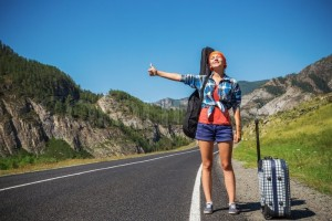 11027685-girl-hitchhiking